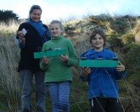 Katie, Ruby and Manu collecting mice traps and tunnels.